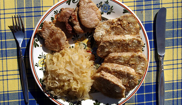roast pork bread dumplings and stewed cabbage are ingredients that make up this hearty dish most czech dishes tend to be heavy on meat and dumplings